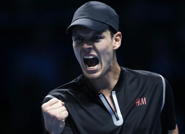 Tomas Berdych of Czech Republic shouts after winning a set against Stanislas Wawrinka of Switzerland during their ATP World Tour Finals single tennis match at the O2 Arena in London Monday, Nov. 4, 2013. (AP Photo/Sang Tan)