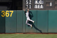 New York Yankees left fielder Joey Gallo catches a fly ball hit by Oakland Athletics' Matt Chapman during the eighth inning of a baseball game in Oakland, Calif., Saturday, Aug. 28, 2021. (AP Photo/Jeff Chiu)