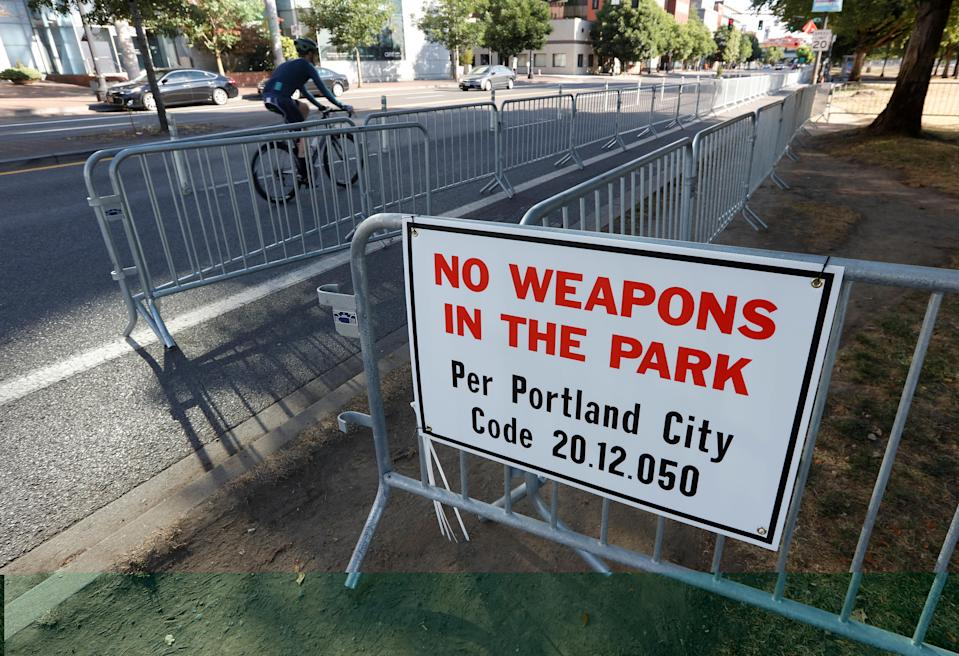 <p>A 'No Weapons' sign is seen at a park where right-wing Patriot Prayer group plan to hold a rally in Portland, Ore., Aug. 4, 2018. (Photo: Bob Strong/Reuters) </p>