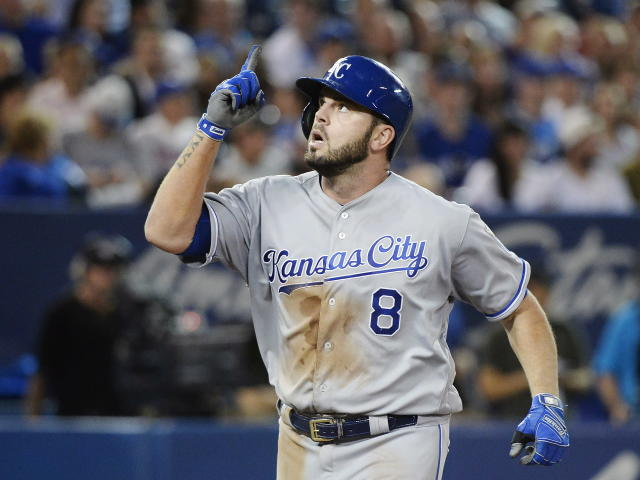FILE - In this Sept. 20, 2017, file photo, Kansas City Royals' Mike Moustakas celebrates his solo home run against the Toronto Blue Jays during the sixth inning of a baseball game in Toronto. With the market soft across the board, the Royals were able to bring back Moustakas on club-friendly, short-term deal. (Nathan Denette/The Canadian Press via AP, File)