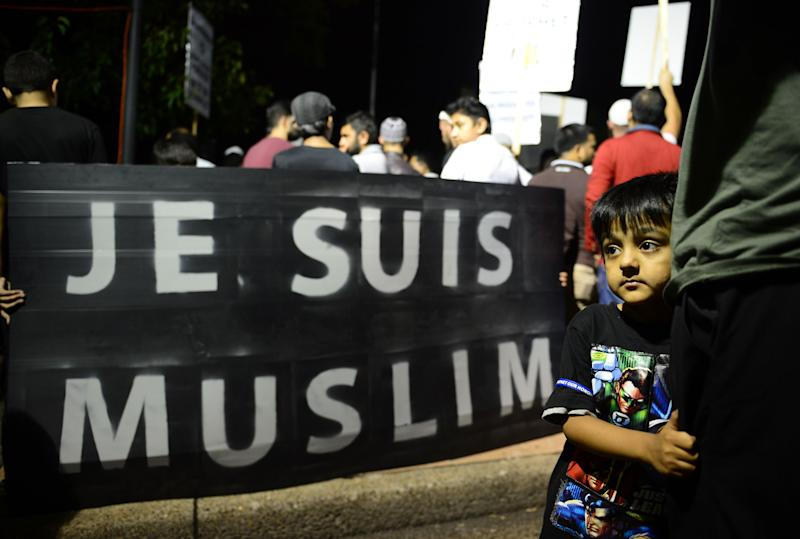 People gather during a rally to protest against negative coverage of Islam and French satirical weekly Charlie Hebdo's caricatures of the Prophet Mohammed, in Sydney on January 23, 2015