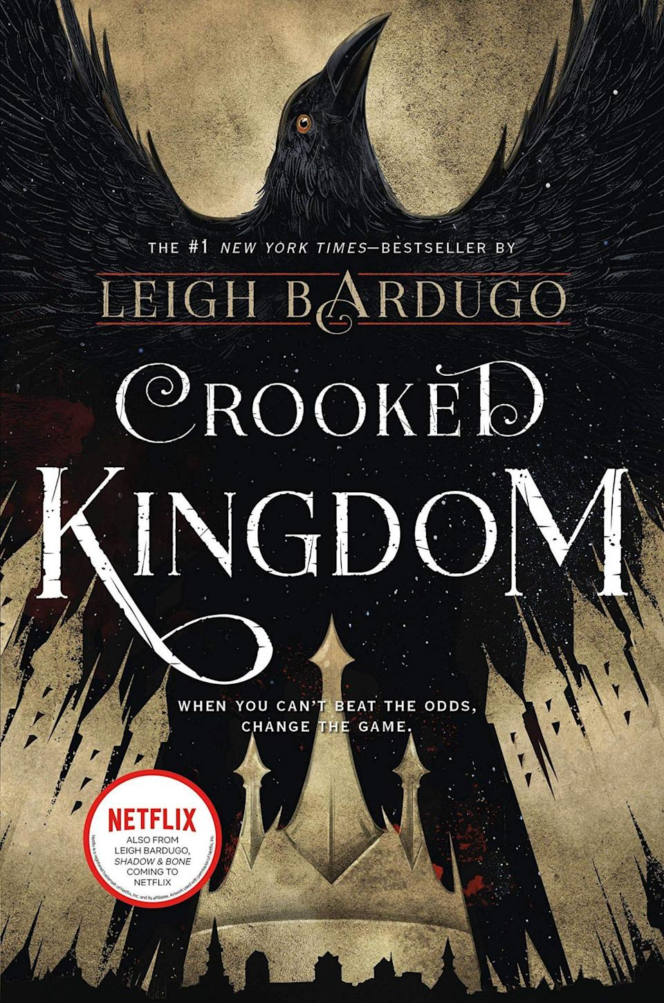 The cover of Crooked Kingdom shows a crow rising