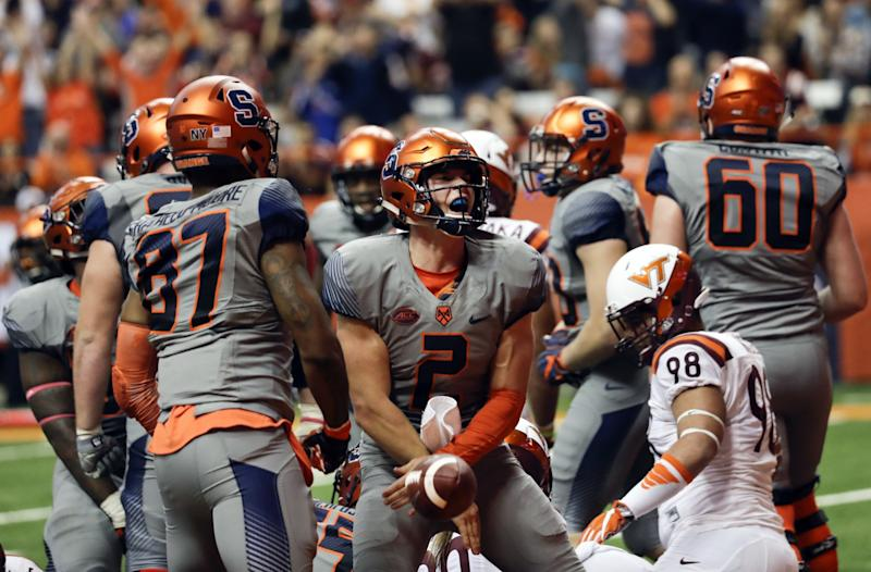 Syracuse QB Eric Dungey combined for 417 yards of offense in a win over Virginia Tech. (AP Photo/Mike Groll)