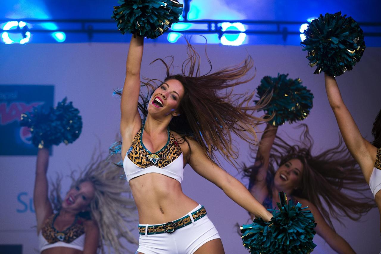 The Jaguars cheerleaders perform on stage during an NFL fan rally in Trafalgar Square, London, Saturday, Oct. 26, 2013.  The San Francisco 49ers are due to play the the Jacksonville Jaguars at Wembley stadium in London on Sunday, Oct. 27 in a regular season NFL game. (AP Photo/Matt Dunham)