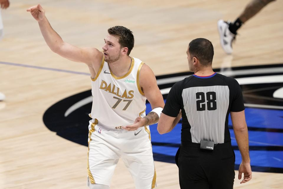 Dallas Mavericks' Luka Doncic (77) talks to referee Mousa Dagher (28) about a call on his attempted shot that was blocked in the first half of an NBA basketball game against the Toronto Raptors in Dallas, Friday, May 14, 2021. (AP Photo/Tony Gutierrez)