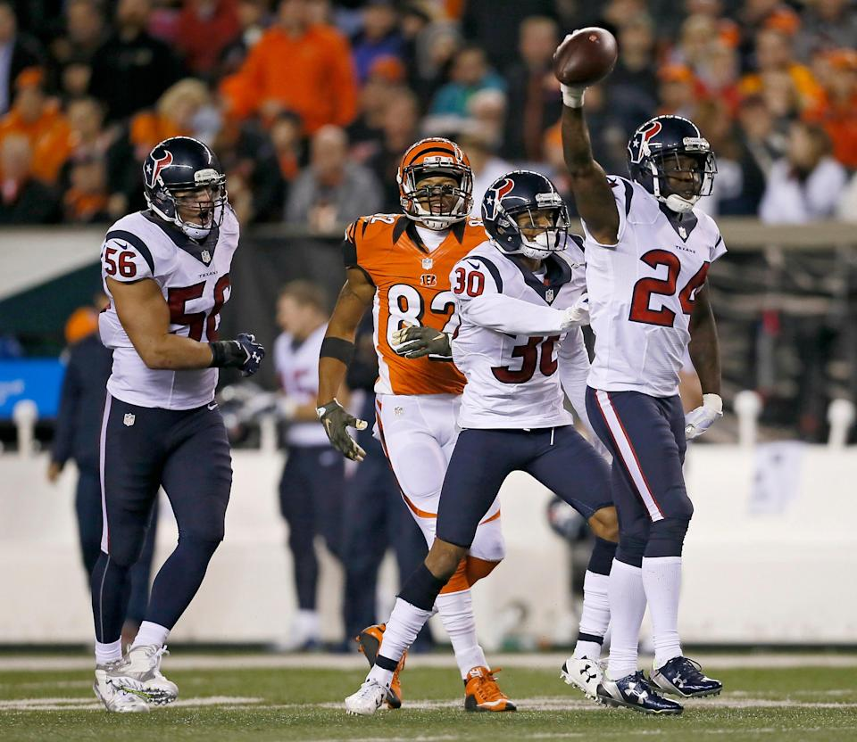 The Houston Texans celebrate an interception by Houston Texans cornerback Johnathan Joseph (24) in the third quarter of the NFL Week 10 game between the Cincinnati Bengals and the Houston Texans at Paul Brown Stadium in downtown Cincinnati on Monday, Nov. 16, 2015. The Bengals fell to 8-1, with a 10-6 loss to the Texans.