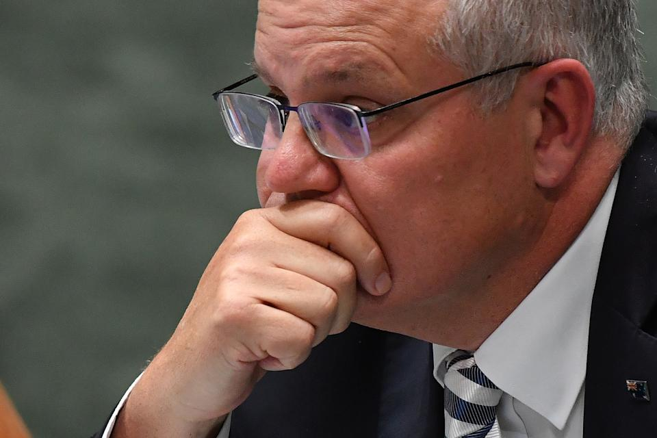 CANBERRA, AUSTRALIA - MARCH 25: Prime Minister Scott Morrison reacts during Question Time in the House of Representatives at Parliament House on March 25, 2021 in Canberra, Australia. The federal government was on Monday set back by new allegations broadcast by the Ten Network after pixelated images of unnamed Coalition advisers allegedly engaging in performing lewd sex acts on the desks of female MPs resulting in a Morrison staff member being sacked last night. Additionally, the ABC Network aired a first hand account by an Australian Parliament security guard of what she witnessed on the night Brittany Higgins was allegedly raped in the office of then-defence industry minister Linda Reynolds in early 2019. (Photo by Sam Mooy/Getty Images)