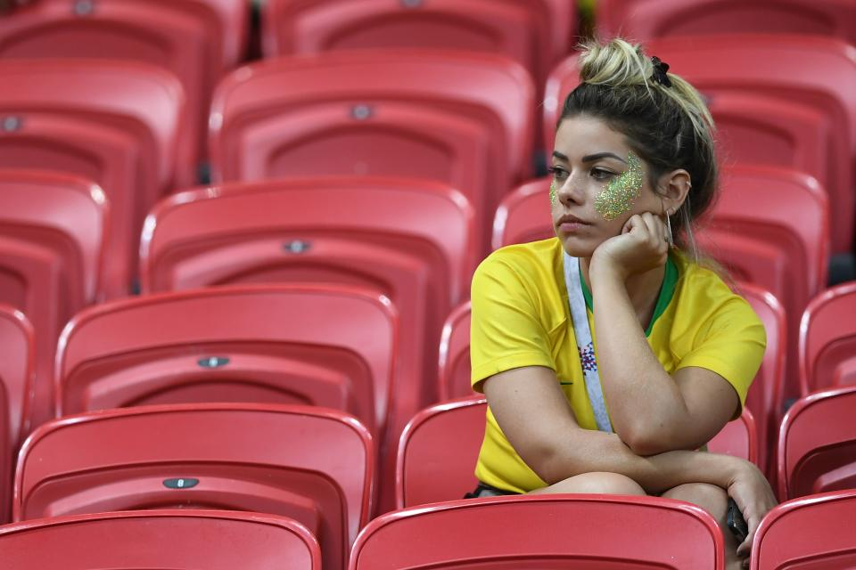 <p>A Brazil fan reacts to their loss during the Russia 2018 World Cup quarter-final football match between Brazil and Belgium at the Kazan Arena in Kazan on July 6, 2018. – Belgium beat World Cup favourites Brazil 2-1 on Friday to set up a semi-final against France in Saint Petersburg. (Photo by Manan VATSYAYANA / AFP) </p>