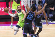 Minnesota Timberwolves guard Ricky Rubio (9) is defended by Sacramento Kings center Hassan Whiteside (20) during the first quarter of an NBA basketball game in Sacramento, Calif., Wednesday, April 21, 2021. (AP Photo/Hector Amezcua)