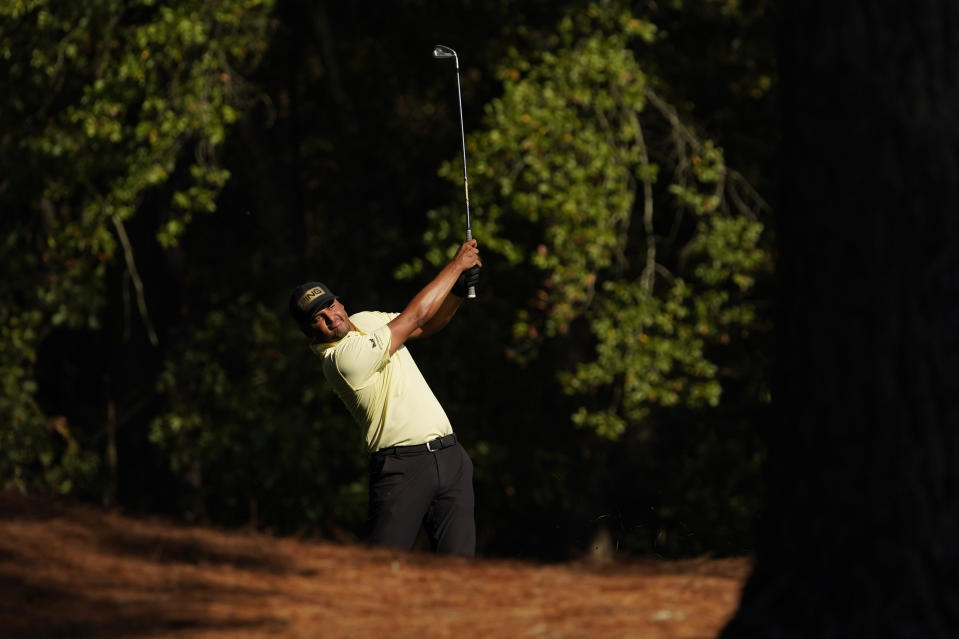 FILE - In this Nov. 14, 2020, file photo, Sebastian Munoz, of Colombia, watches his shot on the 11th hole during the third round of the Masters golf tournament in Augusta, Ga. Munoz was among 13 players who made their debut in November and now play the Masters in April. (AP Photo/David J. Phillip, File)