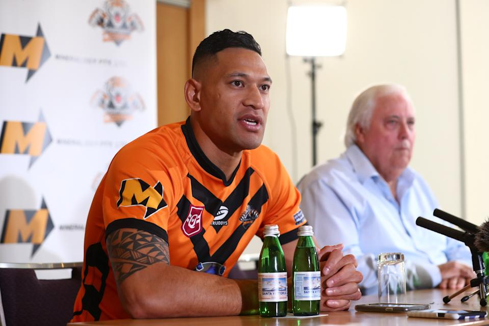 Israel Folau and Clive Palmer speak to the media during a press conference at the Hilton Hotel on May 21, 2021 in Brisbane, Australia.