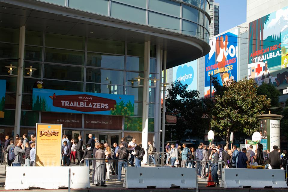 San Francisco, California - November 19th, 2019: A crowd of Dreamforce convention attendees are gathered outside the west entrance of the Moscone Center