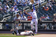 New York Mets first baseman Pete Alonso (20) reaches for a high throw as Baltimore Orioles' Rio Ruiz dives back to first during the second inning of a baseball game, Wednesday, May 12, 2021, in New York. (AP Photo/Kathy Willens)