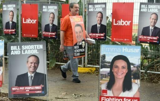 Campaigners prepare from election day. Photo: AFP