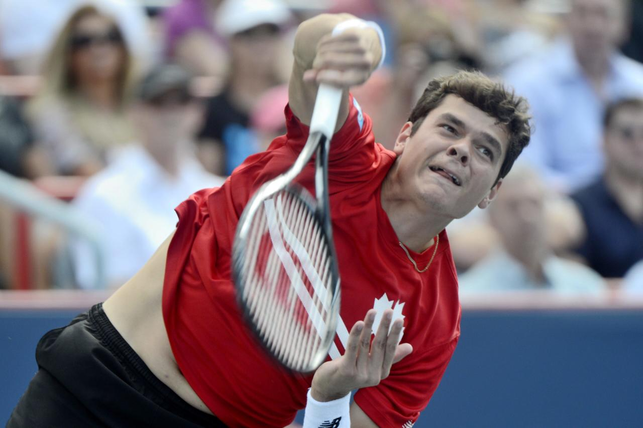 Milos Raonic, of Canada, serves to Rafael Nadal, of Spain, during men's Rogers Cup tennis tournament final action in Montreal, Sunday, Aug. 11, 2013. (AP Photo/The Canadian Press, Paul Chiasson)
