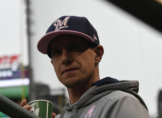 Milwaukee Brewers manager Craig Counsell (30) in the dugout before a baseball game against the Chicago Cubs, Sunday, May, 12, 2019, in Chicago. (AP Photo/David Banks)