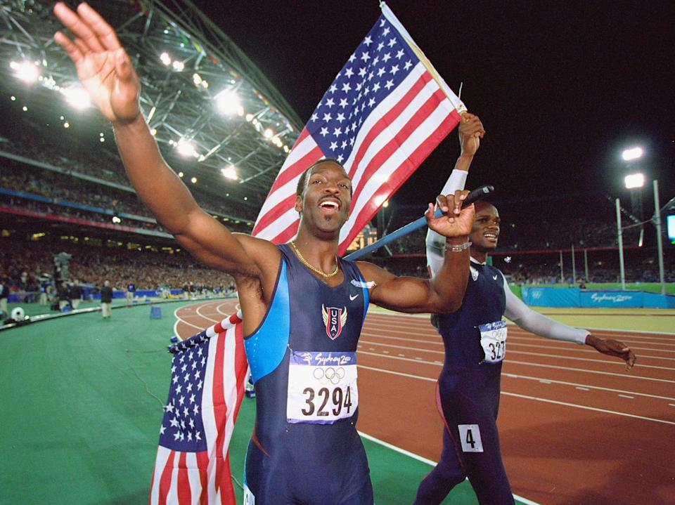 379017 04: Michael Johnson, left, and Alvin Harrison of the USA celebrate their respective Gold and Silver Medal wins in the Mens 400m Final at the Olympic Stadium September 25, 2000 on Day Ten of the Sydney 2000 Olympic Games in Sydney, Australia. Johnson won gold in a time of 43.84 secs. (Photo by Mike Powell/Allsport)