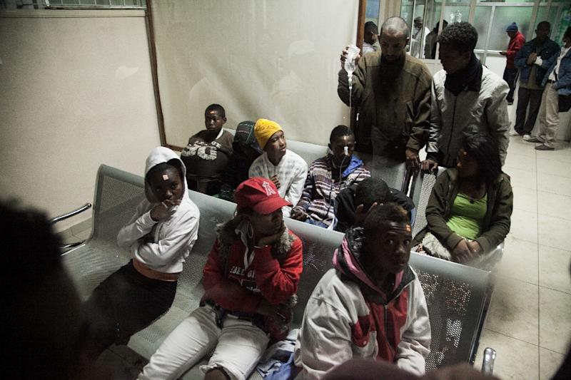 Wounded people sit at the University Hospital of Antananarivo (HJRA) to receive first aid after a bomb blast around 7.30 pm local time at Mahamasina Stadium during Malagasy Independence Day causing 84 wounded and 2 dead on June 26, 2016 (AFP Photo/RIJASOLO)