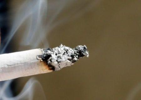 FILE PHOTO: Smoke rises from a burning cigarette in Bordeaux