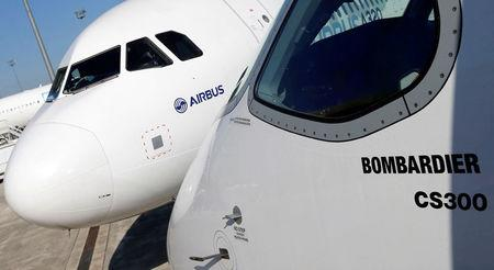 An Airbus A320neo aircraft and a Bombardier CSeries aircraft are pictured during a news conference to announce a partnership between Airbus and Bombardier on the C Series aircraft programme, in Colomiers near Toulouse, France, October 17, 2017.   REUTERS/Regis Duvignau