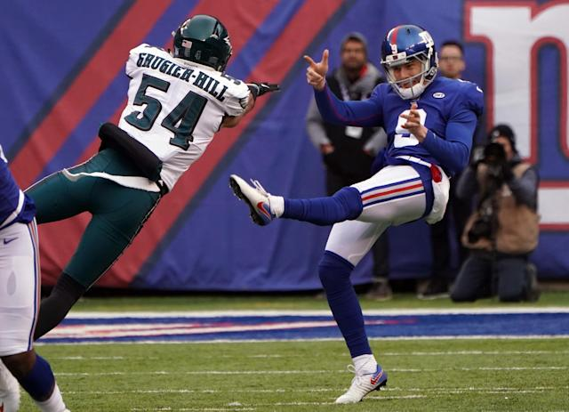 <p>Philadelphia Eagles linebacker Kamu Grugier-Hill (54) blocks a punt by New York Giants punter Brad Wing (9) at MetLife Stadium. Mandatory Credit: Robert Deutsch-USA TODAY Sports </p>