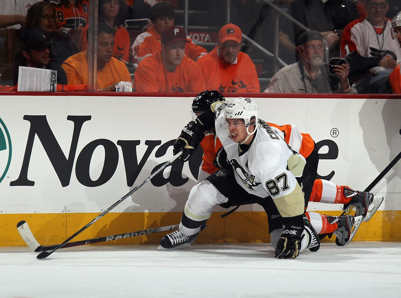 PHILADELPHIA, PA - APRIL 15: Sidney Crosby #87 of the Pittsburgh PBenguins attles to control the puck in the game against the Philadelphia Flyers in Game Three of the Eastern Conference Quarterfinals during the 2012 NHL Stanley Cup Playoffs at Wells Fargo Center on April 15, 2012 in Philadelphia, Pennsylvania. The Flyers defeated the Penguins 8-4. (Photo by Bruce Bennett/Getty Images)