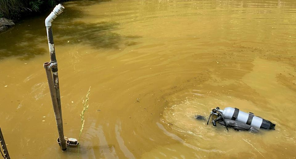 A diver searches for Summer Wells in Tennessee.