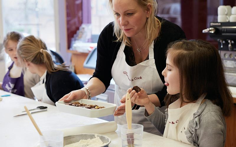 Amy Davies and her daughter, Ava, at the Konditor & Cook baking class - Credit: Kitty Gale
