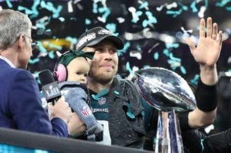 Feb 4, 2018; Minneapolis, MN, USA; Philadelphia Eagles quarterback Nick Foles (9) holds daughter Lily James (C) while waving to the fans after defeating the New England Patriots to win Super Bowl LII at U.S. Bank Stadium. Mandatory Credit: Kirt Dozier-USA TODAY Sports