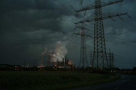 A coal power plant is seen during thunderstorm in western city of Weisweiler