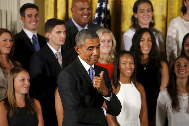 U.S. President Barack Obama reacts during a welcoming reception for the 2015 NCAA Women's basketball champion team, the Connecticut Huskies at the White House in Washington September 15, 2015. REUTERS/Carlos Barria