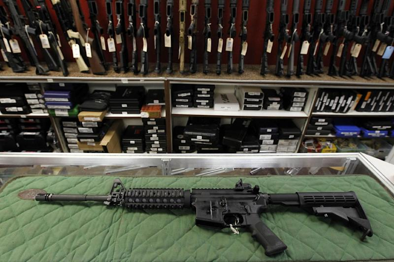 File-In this Thursday, July 26, 2012 file photo an AR-15 style rifle is displayed at the Firing-Line indoor range and gun shop, in Aurora, Colo. Similar weapons have been used in at least four high-profile shootings in the past year, including most recently the Connecticut school shootings and the Christmas Eve killings of two New York firefighters. (AP Photo/Alex Brandon, File)