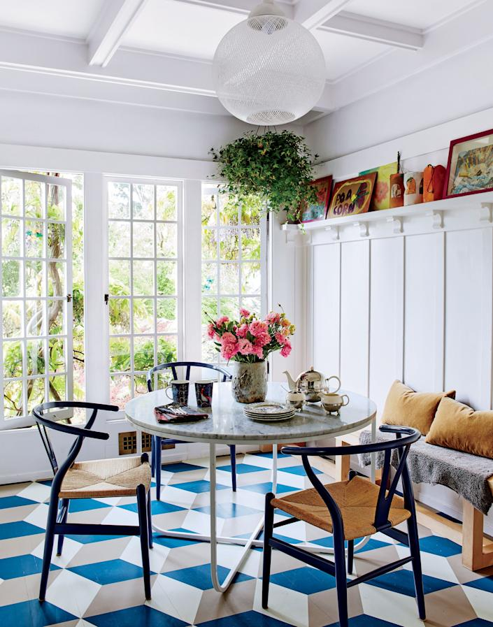 """<div class=""""caption""""> Hans Wegner's famous Wishbone chairs gather around the breakfast table at this family home in Berkeley, California, by Commune Design. </div> <cite class=""""credit"""">Trevor Tondro</cite>"""