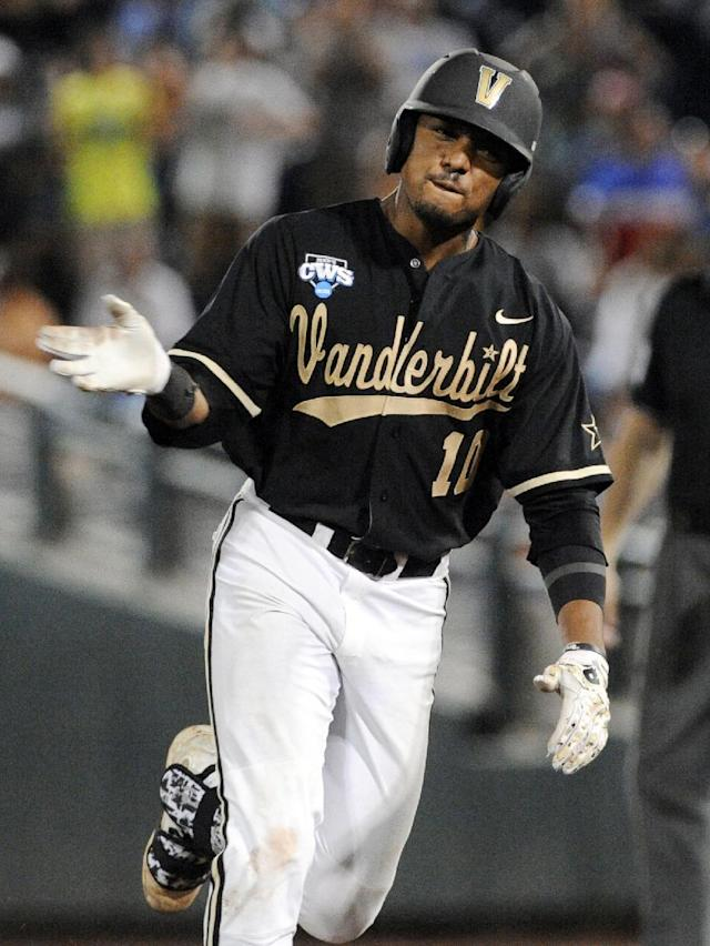 Vanderbilt's John Norwood celebrates as he runs the bases after hitting a home run against Virginia in the eighth inning of Game 3 of the best-of-three NCAA baseball College World Series finals in Omaha, Neb., Wednesday, June 25, 2014. (AP Photo/Eric Francis)
