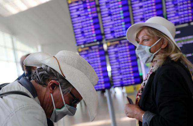 Travellers at an airport in Barcelona, where cases of coronavirus have now sprung up. (Reuters/Nacho Doce)