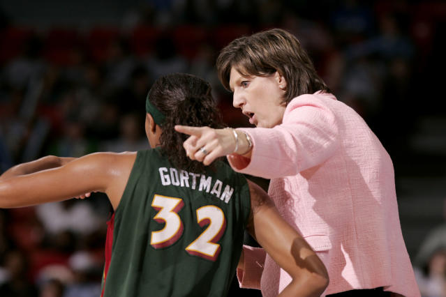 FILE - In this June 15, 2006, file photo, Seattle Storm coach Anne Donovan, right, talks to Shaunzinski Gortman during the fourth quarter of the team's WNBA basketball game against the Chicago Sky in Chicago. The Storm won 74-61. Donovan, the Basketball Hall of Famer who won a national championship at Old Dominion, two Olympic gold medals in the 1980s and coached the U.S. to gold in 2008, died Wednesday, June 13, 2018, of heart failure. She was 56. Donovan's family confirmed the death in a statement. (AP Photo/Jeff Roberson, File)