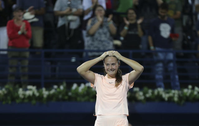 Daria Kasatkina of Russia celebrates after she beats Garbine Muguruza of Spain during a semi final match of the Dubai Duty Free Tennis Championship in Dubai, United Arab Emirates, Friday, Feb. 23, 2018. (AP Photo/Kamran Jebreili)