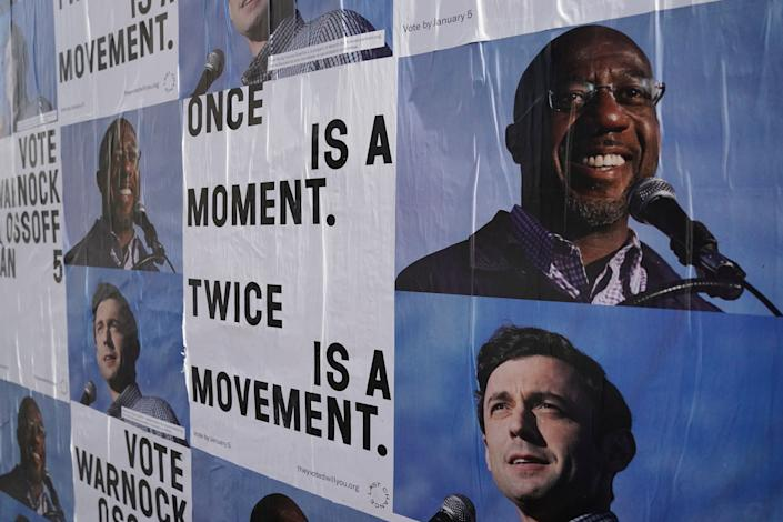 Campaign ads for Jon Ossoff and Raphael Warnock are seen on a wall near the John Lewis mural the day after the U.S. Senate runoff elections in Atlanta. (Photo: Elijah Nouvelage / Reuters)