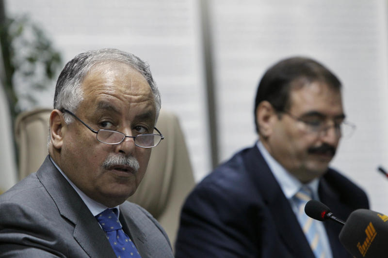 "In this photo taken on a government-organized tour, Libyan Prime Minister Al-Baghdadi al-Mahmoudi, left, and Oil Minister Omran Bokraa listen during a press conference at the Oil Ministry in Tripoli, Libya, Thursday, July 14, 2011.  Libya's prime minister says the government has barred Italy from participating in his country's oil sector, citing Rome's role in the NATO airstrikes on the North African nation. Al-Mahmoudi, however, left the door open for other countries to continue their operations in Libya's vital oil sector as long as they ""reviewed"" their participation in the alliance's airstrikes, which are targeting forces loyal to Libyan leader Moammar Gadhafi. (AP  Photo/Tara Todras-Whitehill)"