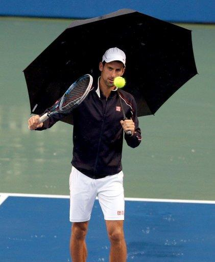 Novak Djokovic of Serbia hits the ball on the Stadium Court during a rain delay on day 6 of the Rogers Cup Presented By National Bank at Rexall Centre at York University, on August 9, in Toronto, Ontario, Canada