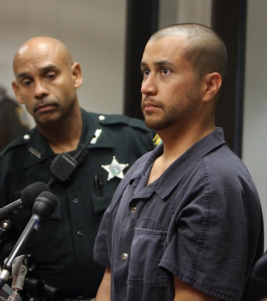 George Zimmerman, right, stands with a Seminole County Deputy during a court hearing Thursday April 12, 2012, in Sanford, Fla. Zimmerman has been charged with second-degree murder in the shooting death of the 17-year-old Trayvon Martin. (AP Photo/Gary W. Green, Orlando Sentinel, Pool)