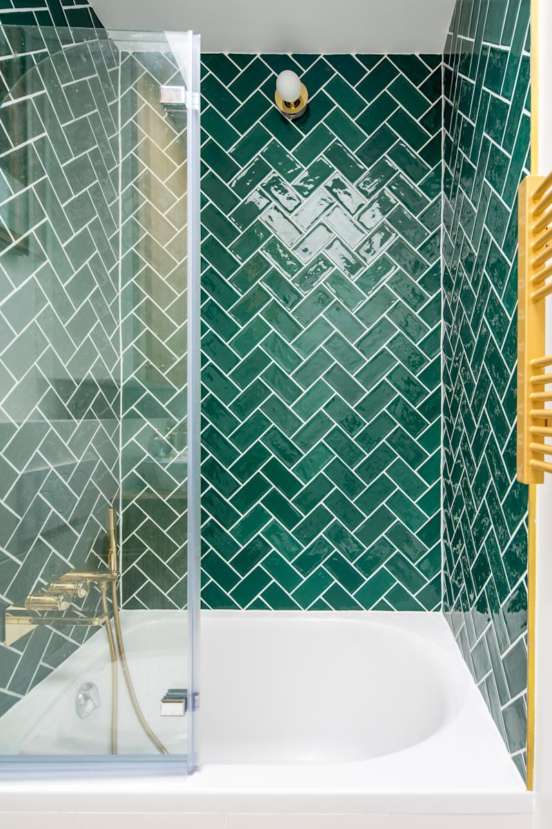 After: What Thomas calls a bâton rompu tiling is also known as the zigzag herringbone pattern. The rich emerald green echoes the accent walls in the rest of the space.