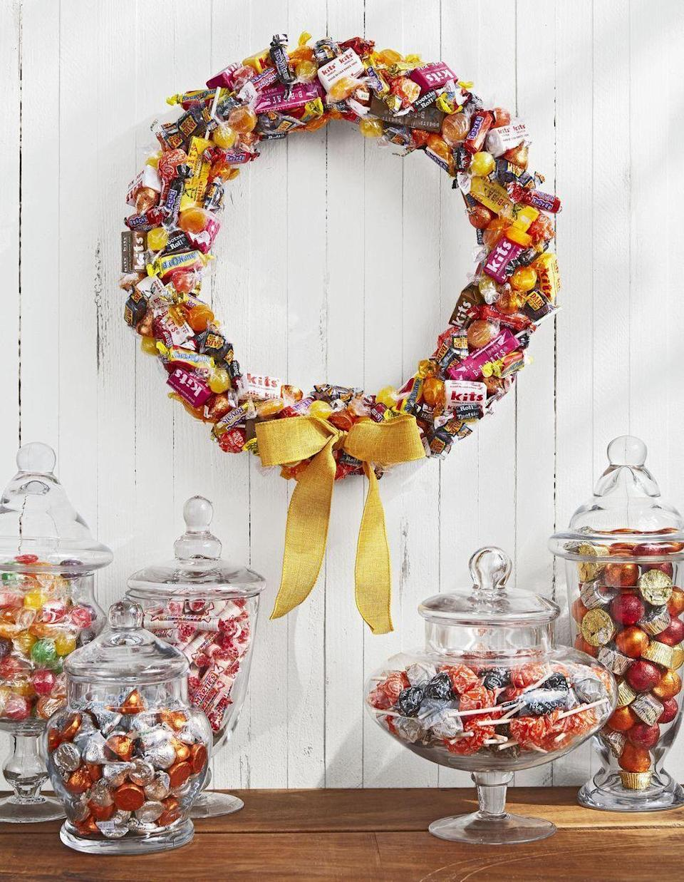 <p>You'll need the whole fam for this sweet craft—kids to curate the candy selection (they're the experts, right?!) and a grown-up to handle the glue gun. Cover a wreath form with treats, then finish it off with a colorful ribbon. </p>