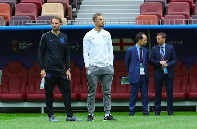 Taking it in: Southgate and Jordan Henderson take a stroll on the pitch at the Luzhniki Stadium in Moscow. (Aaron Chown/PA)