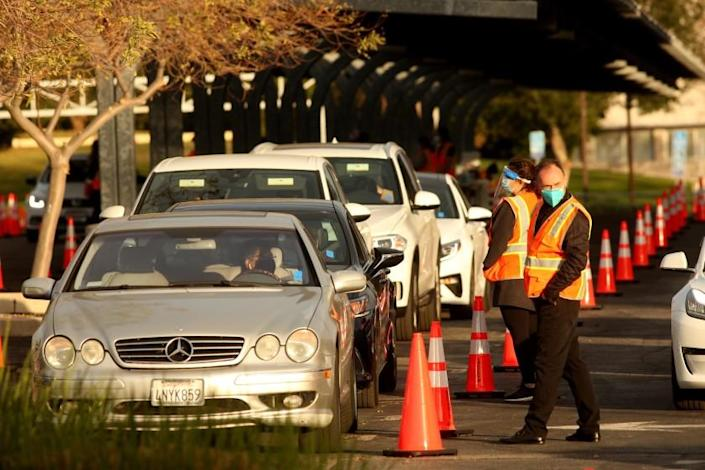 NORTHRIDGE, CA - JANUARY 14, 2021 - After receiving the vaccine against COVID-19 motorists wait in a staging area for 15 minutes to make sure there are no side effects from the shot on the first day at the large scale COVID-19 vaccine site at California State University Northridge in Northridge on January 19, 2021. Los Angeles County opened four other large-scale vaccine sites Tuesday -- at Six Flags Magic Mountain, the Pomona Fairplex, the L.A. County Office of Education in Downey and The Forum in Inglewood. The sites will eventually have the capability to vaccinate 4,000 people each on a daily basis -- depending on vaccine availability. Los Angeles County began scheduling COVID-19vaccination appointments for residents aged 65 and older today, advancing an effort that wasn't expected to start until February, but limited vaccine supplies and uncertainty about future allocations has left the inoculation effort shrouded in doubt. County Public Health Director Barbara Ferrer said there are adequate vaccine supplies to get through this week's appointments -- about 50,000 of them at the public sites -- but the county has no idea how many more doses it'll be getting next week. (Genaro Molina / Los Angeles Times)