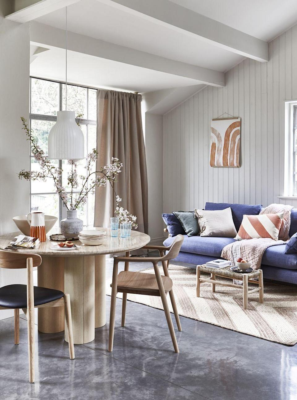 """<p>Japandi is an effortlessly elegant trend that will work in any room of the house – especially in a large open-plan living space.</p><p>'With wood at the heart of the Japandi trend, it's time to make a feature of the dining table. Pair a solid statement piece with upholstered chairs, in a soft, muted tone and finish off with a Scandi-inspired patterned rug. If space is at a premium, opt for quality over quantity and invest in a wooden console table or storage unit,' says Antonia Wheeler, Design Director at <a href=""""https://www.arighibianchi.co.uk/"""" rel=""""nofollow noopener"""" target=""""_blank"""" data-ylk=""""slk:Arighi Bianchi"""" class=""""link rapid-noclick-resp"""">Arighi Bianchi</a>.</p>"""