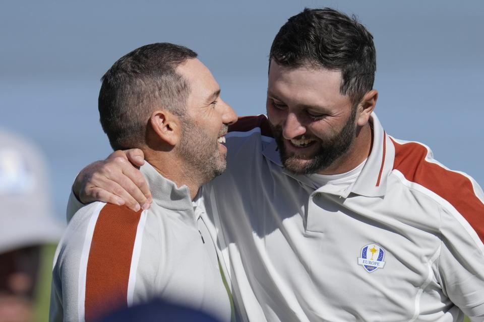Team Europe's Sergio Garcia and Team Europe's Jon Rahm celebrate after winning their foursomes match the Ryder Cup at the Whistling Straits Golf Course Saturday, Sept. 25, 2021, in Sheboygan, Wis. (AP Photo/Ashley Landis)