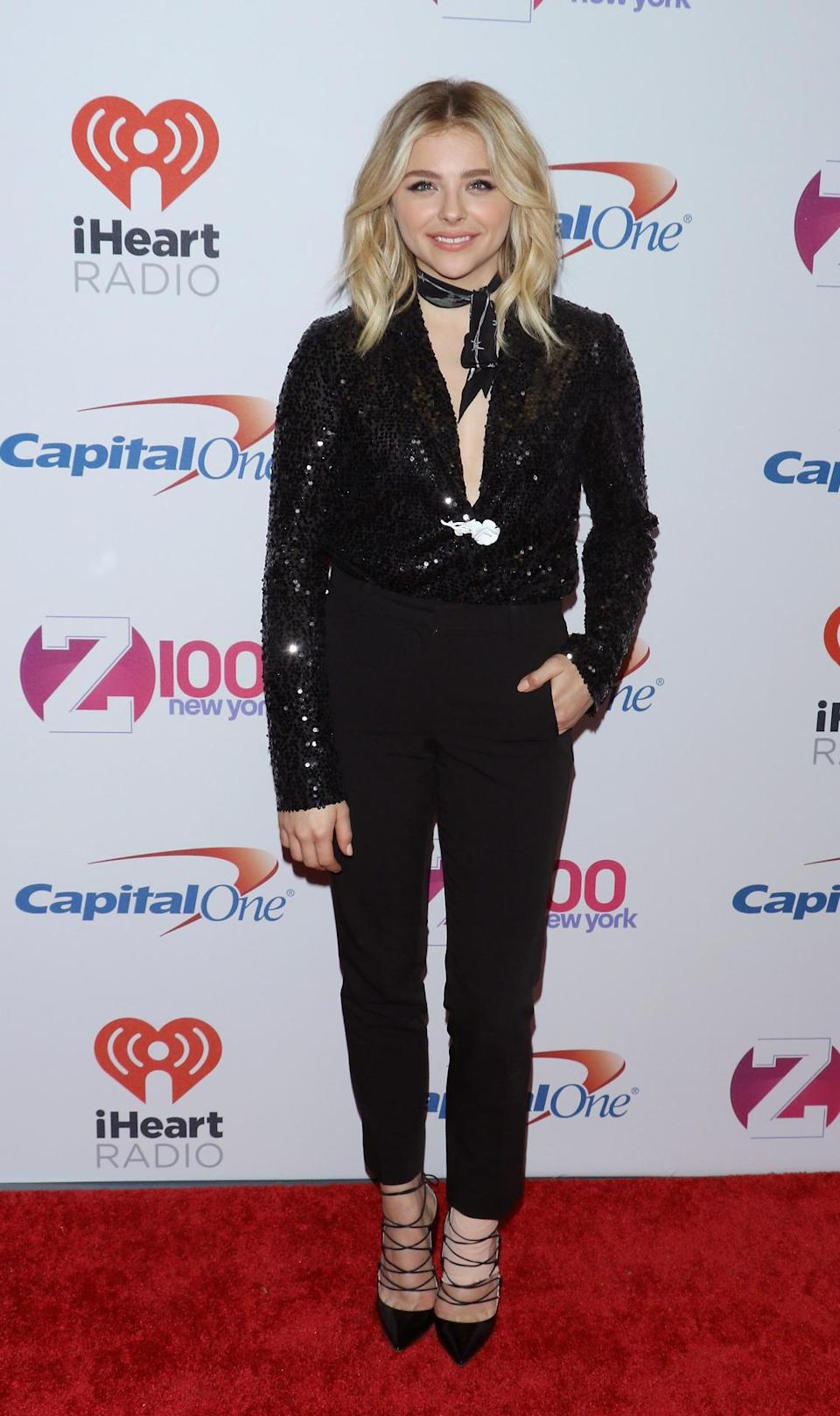 <p>The actress looked as if she was having a bit of trouble in the ankle department, but that didn't stop her from rocking her lace up high heels! Black trousers and a sparkly plunging long sleeve blouse constituted her look for the evening, which she finished off by tying a scarf around her neck.</p>