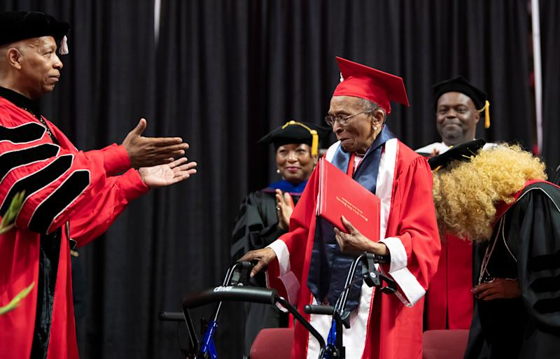 Elizabeth Barker Johnson walks across the graduation stage to receive her Winston-Salem State University diploma nearly 70 years after finishing her degree. (Credit: Winston Salem State University)