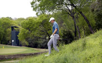 Jordan Spieth walks through the rough on the third hole after hitting an errant during round-robin play at the Dell Technologies Match Play Championship golf tournament, Thursday, March 28, 2019, in Austin, Texas. (AP Photo/Eric Gay)